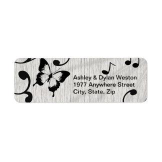 Símbolos de música, borboleta, folhas em etiquetas etiqueta endereço de retorno