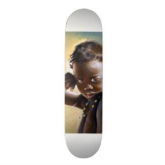 Skate africano do verão da criança