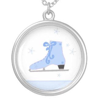 Skate de gelo azul pingente
