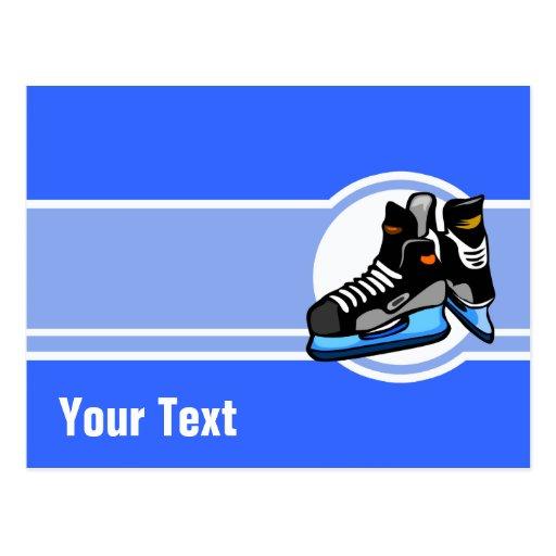 Skates do hóquei; Azul Cartao Postal