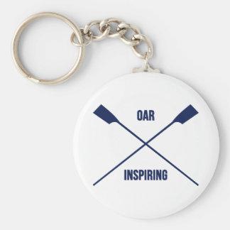 Slogan de inspiração do remo e marinho cruzado dos chaveiro