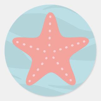Sob a etiqueta dos peixes da estrela de mar adesivo