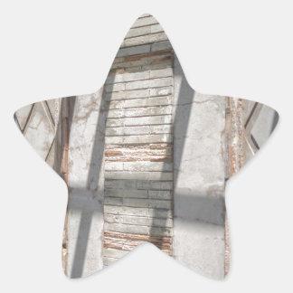 Sombras contra uma parede adesito estrela