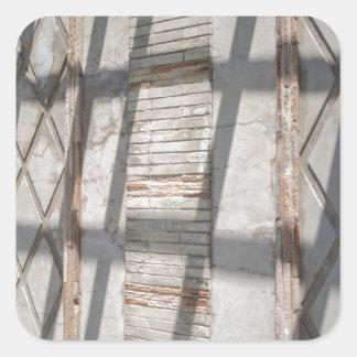 Sombras contra uma parede adesivo quadrado