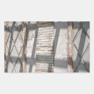 Sombras contra uma parede adesivo retangular