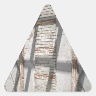 Sombras contra uma parede adesivo triangular