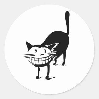 Sorrindo o gato adesivo em formato redondo