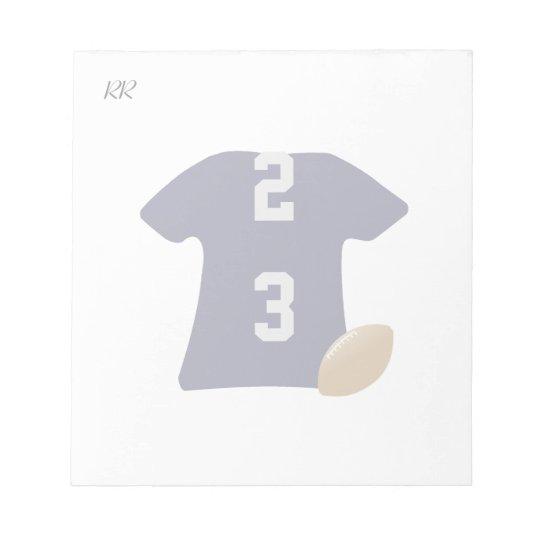 Sua camisa do futebol com a bola no bloco de notas