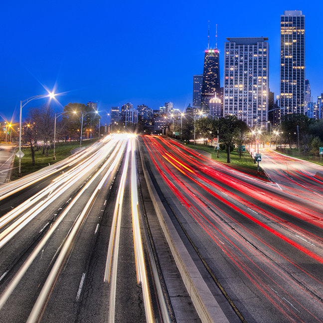 Light trails at night against city at night