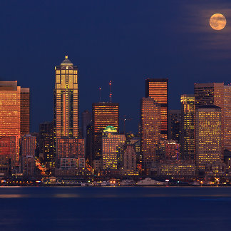 Full moon rising over downtown Seattle skyline