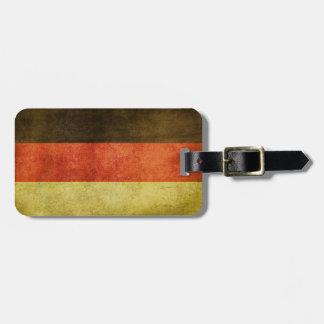 Tag da bagagem com a bandeira suja do vintage de etiqueta de mala