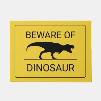 Tapete Beware do Doormat engraçado do dinossauro