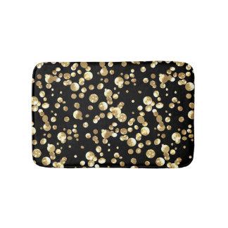 Tapete De Banheiro Bolinhas do ouro em um fundo preto.