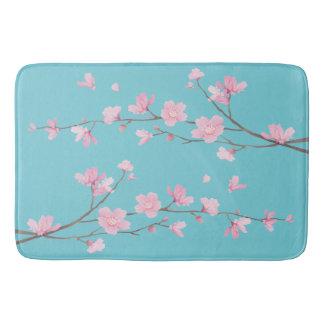 Tapete De Banheiro Flor de cerejeira - azul do ovo do pisco de peito