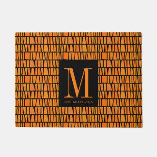 Tapete Monograma alaranjado inspirado africano do estilo