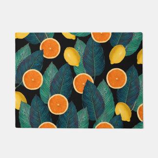 Tapete preto dos limões e das laranjas