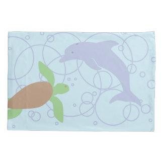 Tartaruga e golfinho de mar