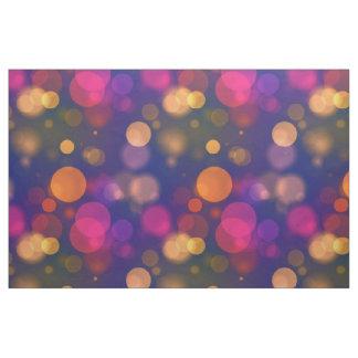 Tecido Bokeh roxo, azul, cor-de-rosa brilhante ilumina o