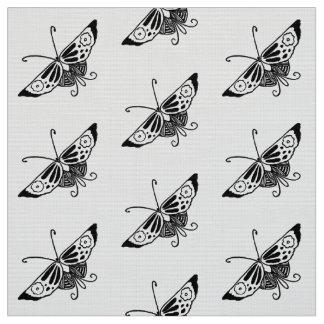 Tecido Borboleta estilizado de Deco, preto e branco