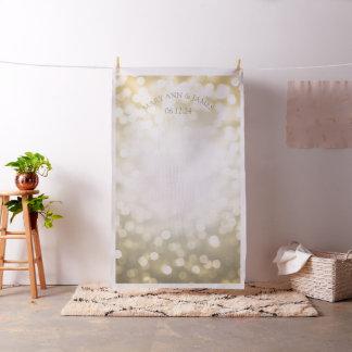 Tecido O ouro Bokeh ilumina o contexto da foto do