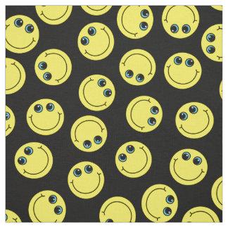 Tecido Os smileys face amarelos escolhem a cor do fundo