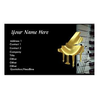 Teclado de piano do ouro e cartão de visita das no