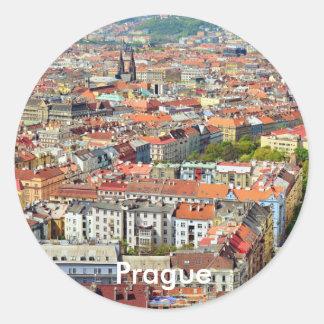 Telhados da etiqueta redonda de Praga