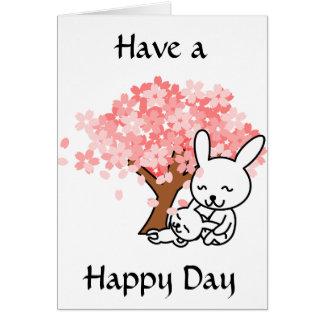 Tenha um dia feliz, coelhos bonitos sob o cartão