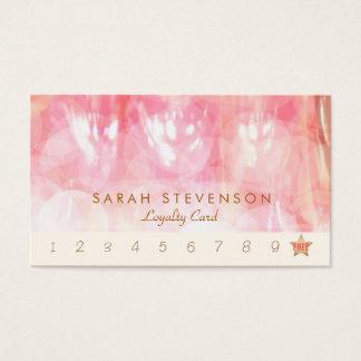 Termas de Bokeh e cartão de perfurador cor-de-rosa
