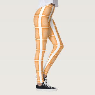 Teste padrão alaranjado da malha legging
