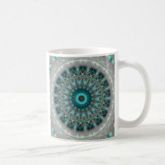Teste padrão azul do caleidoscópio da mandala da caneca de café