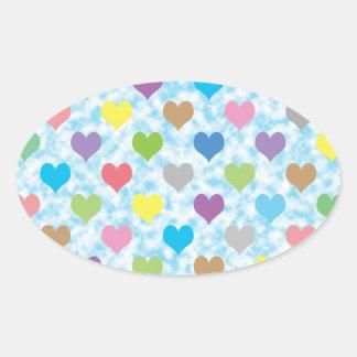Teste padrão colorido dos corações no fundo azul adesivo oval