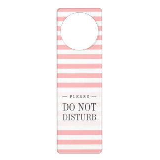 Teste padrão cor-de-rosa e branco da listra sinais para portas