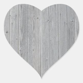 Teste padrão de madeira velho da textura adesivo coração
