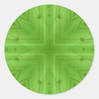 Teste padrão de madeira verde da textura adesivo redondo