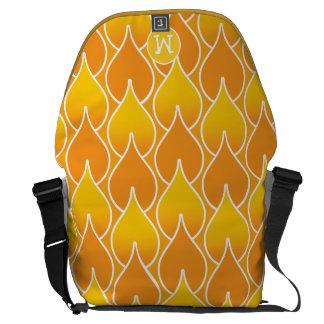 Teste padrão geométrico alaranjado e amarelo do bolsas mensageiro