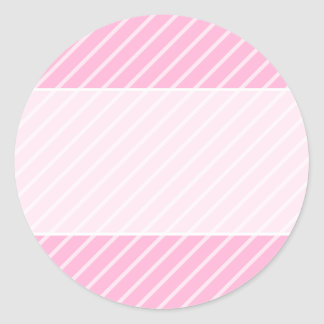 Teste padrão listrado diagonal cor-de-rosa dos adesivos em formato redondos