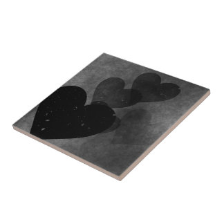 Teste padrão preto dos corações azulejos de cerâmica