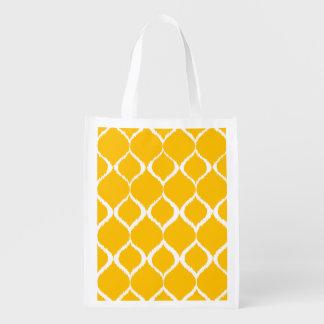 Teste padrão tribal geométrico amarelo dourado do sacolas ecológicas