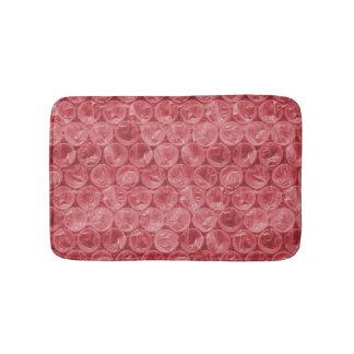 Teste padrão vermelho do invólucro com bolhas de tapete de banheiro