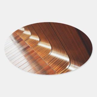 Textura de madeira polonesa curvada adesivos em formato oval