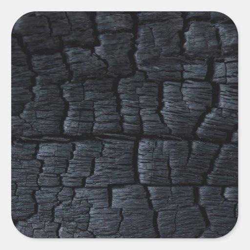 Textura de madeira queimada do falso adesivo quadrado