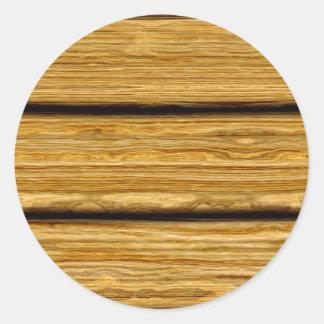 textura resistida dos conselhos de madeira adesivo em formato redondo