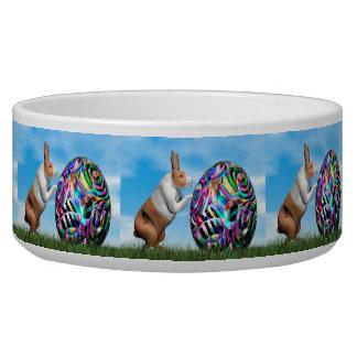 Tigela Coelho que empurra o ovo da páscoa - 3D rendem