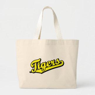 Tigres no amarelo bolsa para compras