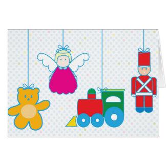 Toys hanging Holidays card. Cartão Comemorativo