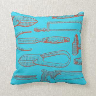Travesseiro azul e vermelho da ferramenta almofada