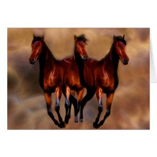 Três cavalos em um cartão comemorativo