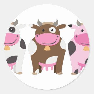 Três vacas adesivos em formato redondos