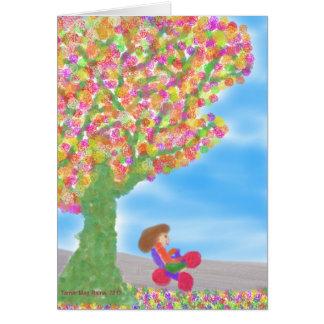 Triciclo sob um cartão mágico da árvore